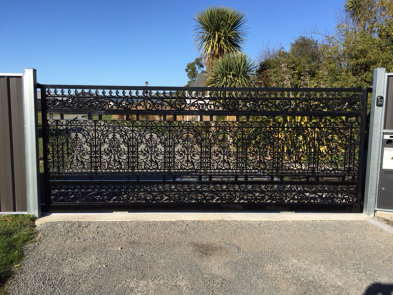 Aluminium gates with cast insert panels