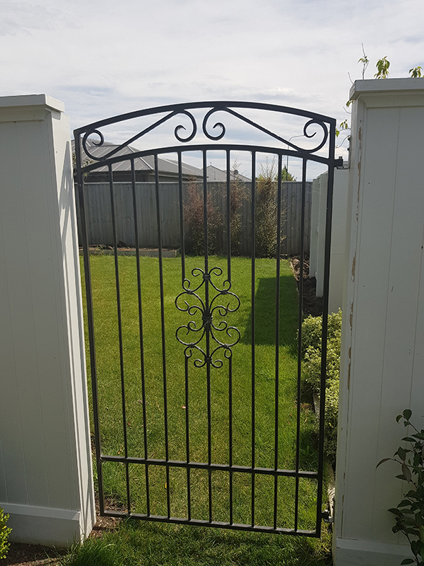 Curved top open railed gate with scrolls